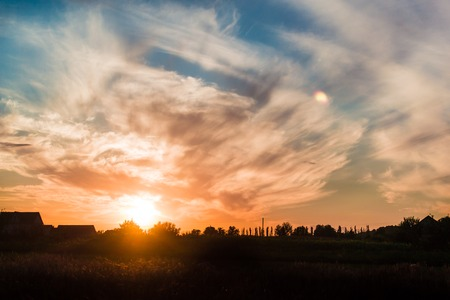 fascinating: Beautiful sunset in summer. Fascinating nature.Golden sky and clouds.