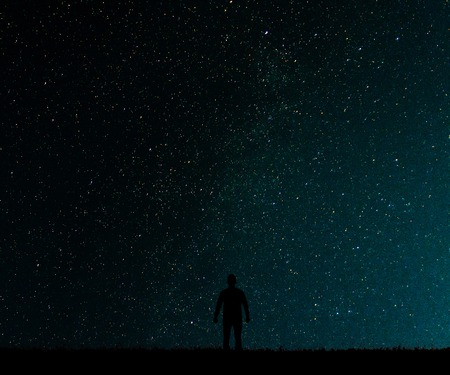desires: Silhouette of man on a background of stars..Man desires guess looking at the stars.