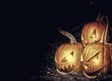 Scary lantern halloween pumpkin with candle light inside.Three crazy Lantern pumpkin. Stock Photo