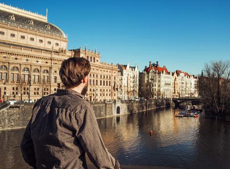 riverbank: A man looks at the river. Prague. Stock Photo