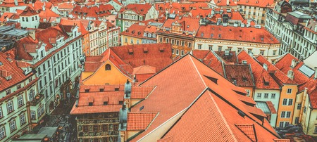 townscape: View to the colorful roofs and houses of Vysegrad in Prague, Czech Republic at autumn - aerial image, travel seasonal vintage hipster background Stock Photo