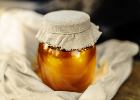 drizzler: Two cans of natural honey. Honey on the fabric.