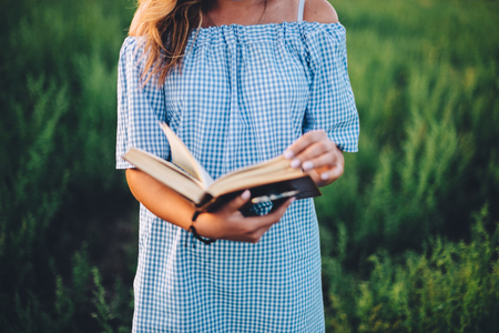 beautiful woman reading a book in the nature Stock Photo
