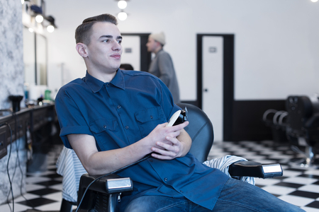 Barber on the chair. Barber expects the client to sit in the chair.