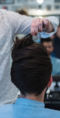 Barbershop. Close-up of a mans haircut, master Barber Shop does the hair styling Stock Photo