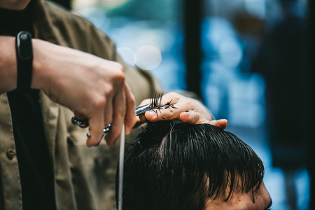 Men's haircut in barbershop. The process of haircuts is a great plan.