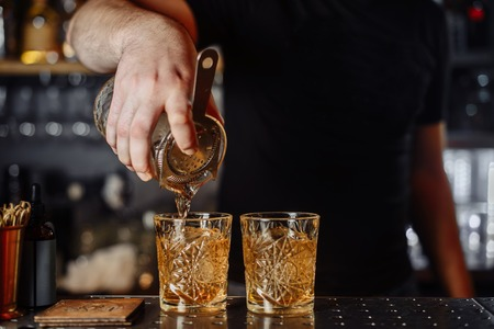 Cocktail Preparation. The barman is preparing a drink. Reklamní fotografie