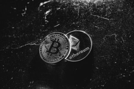 Bitcoin on a dark background. Ethereum and bitcoin rise and fall in price.