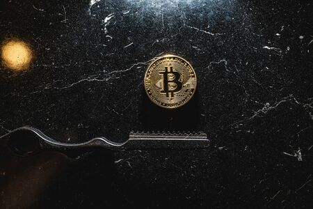 Bitcoin on a dark background. Cryptocurrency is the currency of the future. Modern currency is conquering the economy.