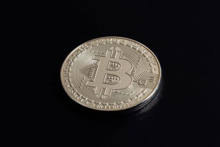 Bitcoin on black background. Cryptocurrency trading. Macro photo Stock Photo