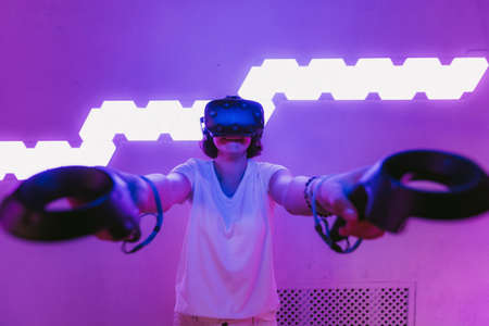 Girl playing virtual reality games. Home entertainment.