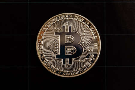 Bitcoin on a black background.