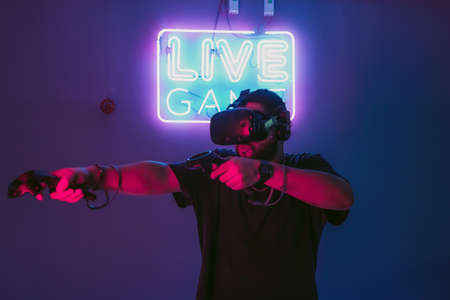 Live games in virtual reality. The guy in the game outfit.