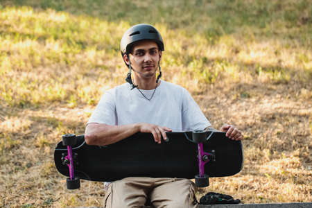 Portrait of a guy with a board in his hands.