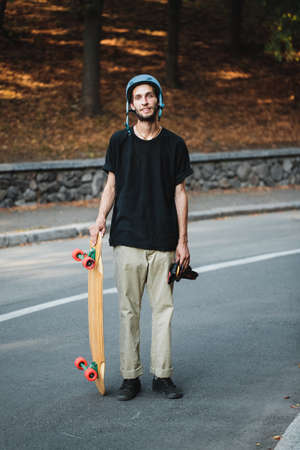 Longboarding and skateboarding. Summer vacation outside the city.
