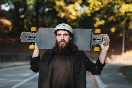 Lifestyle style of sketching, longboard. Portrait of a bearded guy with a board.