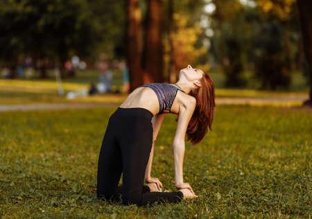 Plastic girl doing yoga. Health care. Standard-Bild