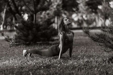 Woman exercising in nature. Fitness in the park.