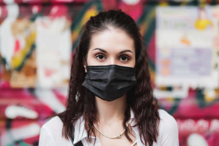 Young woman in a black mask. Protection against �ovid-19 Standard-Bild