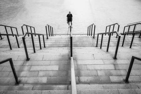 A man stands in the center of the stairs.