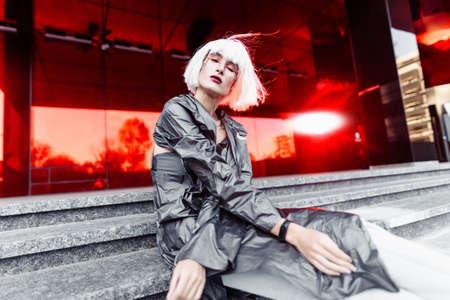 Futuristic fashion. Blonde on a red futuristic background.