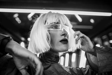 Female futuristic portrait. Woman in cyber glasses.