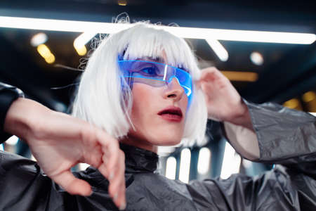 Woman in neon glasses. Cyberpunk and the future