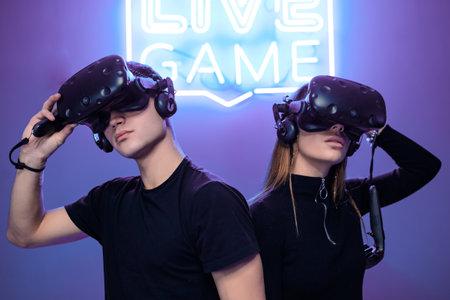 Cyber battle in VR reality. Playing in a neon room. Standard-Bild