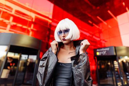 Futuristic blonde with glasses.