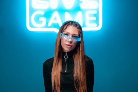 Beautiful woman in neon glasses.