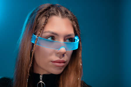Young woman in cyber glasses. Gadgets of the future.