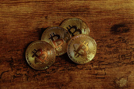 Bitcoins on a wooden background.