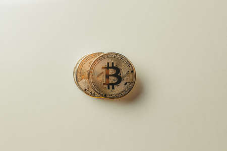 Bitcoin on a yellow background. Standard-Bild - 162757376