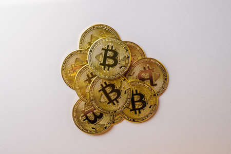 Bitcoins on a pink background.