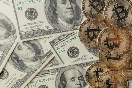 Currency dollar and online currency bitcoin.