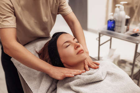 The woman is massaged face and body.