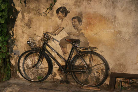 Street art ´Little Children on Bicycle´ by Luthuanian Ernest Zacharevic, Georgetown, Malaysia on February 3, 2020