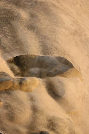 Smooth abstract shapes on cream white flowing stone cave wall, which looks like cave painting. Standard-Bild