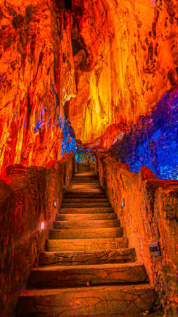 Stairway to heaven or hell. These stone stairs going up in Batu Caves and has hanging stalactites above.