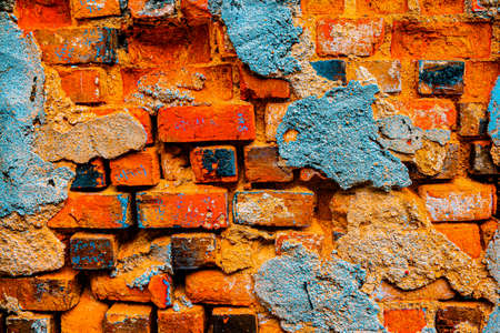 Digital painting art from a damaged brick wall in brown yellow turquoise blue. Standard-Bild