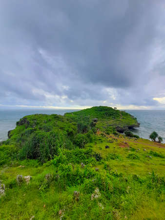 High angle view from a rocky beach with a cliff in Gunung Kidul area