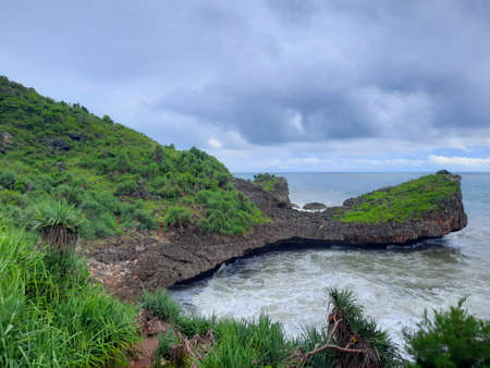 High angle view from a rocky lagoon beach with a cliff in Gunung Kidul area