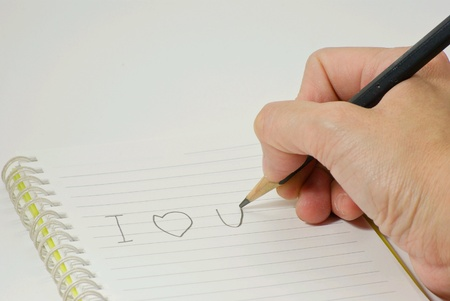 Writes the word I love you Stock Photo