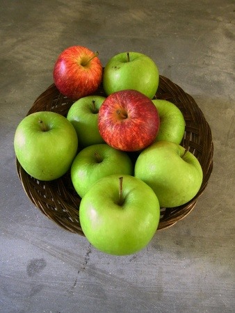 Apples in the basket , cement background