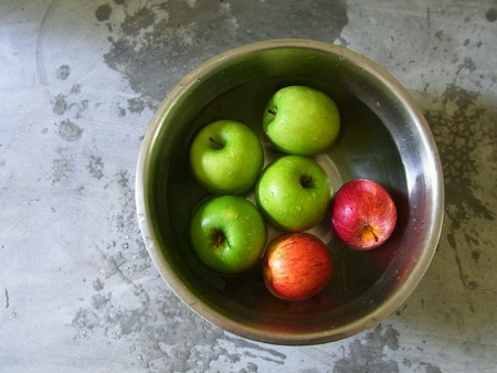 bowel: Apples in the bowel, cement background Stock Photo