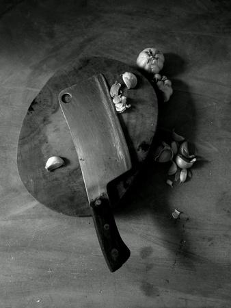 Garlic on the wooden cutting board