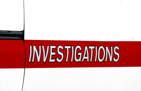 Sign on the side of a fire department vehicle that says investigations