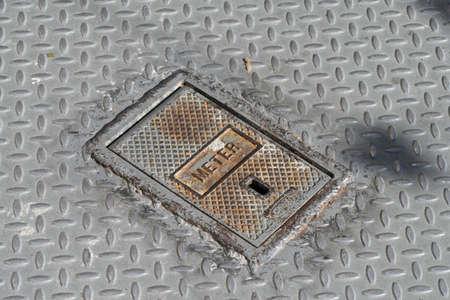 Manhole cover for a meter Banco de Imagens