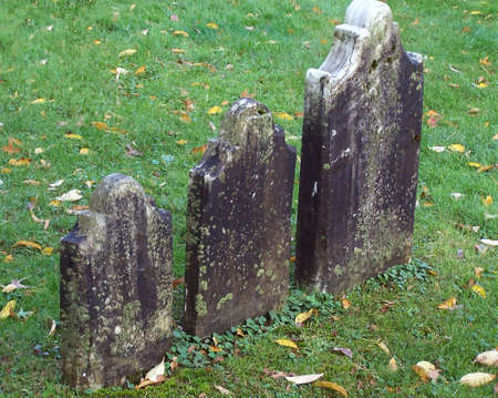 Three tombstones in a graveyard in Vermont