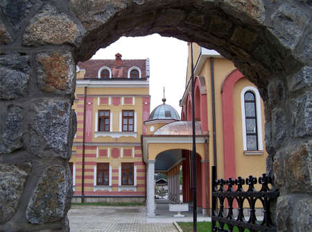 bosna and herzegovina: A Serbian Orthodox church in Dubica, Bosnia, viewed through an archway
